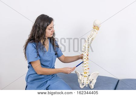 Doctor Showing A Skeleton To A Patient. Back Pain