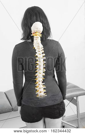 Patient with fake skeleton in her back.