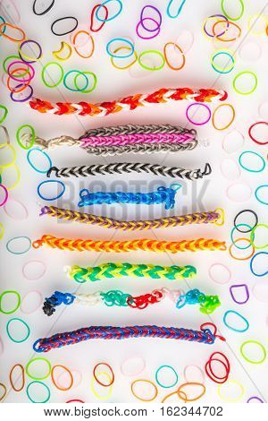 Set of assorted colorful wristbands made by loom bands. Children's favorite hobby.