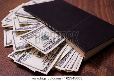 black book and moneybusiness plan money background hundred dollar bills front side. background of dollars money in the black book the work of a writer
