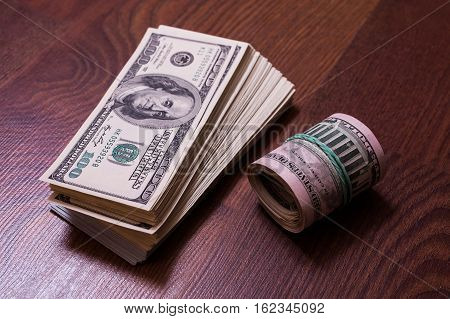twisted money heap stack money hundred dollar bills front side. background of dollars fan of money millionaire fifty dollar bills
