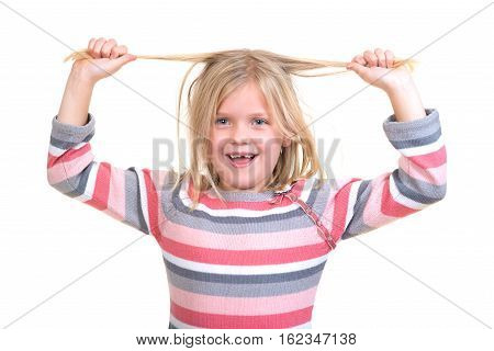 Hair care concept with portrait of girl holding her unruly, tangled long hair isolated on white.