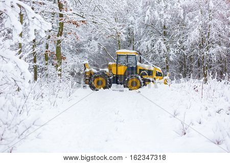 Snow plow on winter road. Winter landscape with machine (snow plow at work)