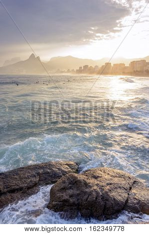 View of the beautiful sunset at Arpoador beach with Ipanema Leblon and Two Brothers hill in the background Rio de Janeiro