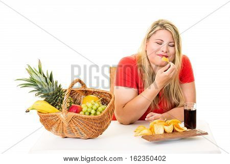 Unhealthy Woman Eating Junk Food Rather Than Fruit