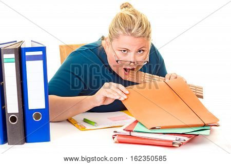 Overweight Businesswoman Biting Hidden Chocolate