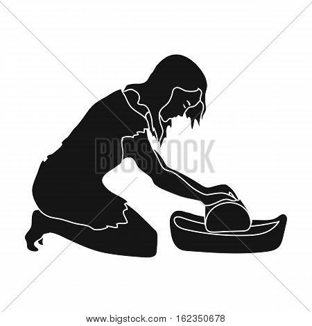 Cavewoman with grindstone icon in black style isolated on white background. Stone age symbol vector illustration.