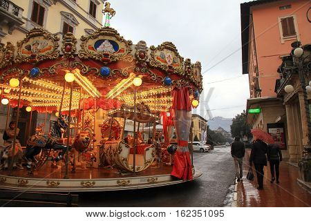 MONTECATINI-TERME, ITALY - JANUARY 8, 2016: Vintage carousel on the street in rainy winter day, Montecatini Terme, Italy