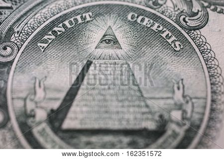 all-seeing eye truncated pyramid closeup money background one dollar bill down back reverse side background of dollars close up America