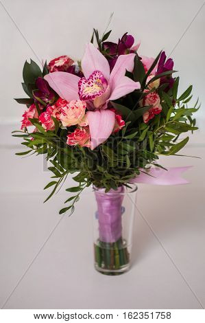 wedding flowers wedding bouquet of red and pink peach yellow roses and blue violet purple orchid bouquet of blue purple purple flowers roses orchids preparing for the wedding wedding decorations