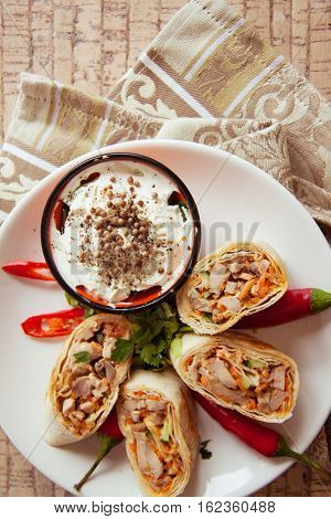 traditional food: spicy armenian shawarma on plate