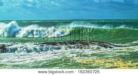 Breaking surf as a result of Seven meter(22 ft) seas just out side the entrance to Coffs Harbour. Photographed in New South Wales Australia.
