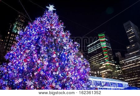 The Bryant Park Christmas tree with buildings in the background in midtown Manhattan.