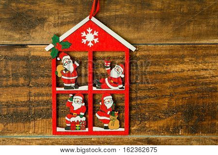 Beautiful hanging for the Christmas�´s tree with Santa Claus at home on a rustic background