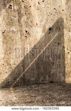 Interesting triangular shadow pattern on concrete wall