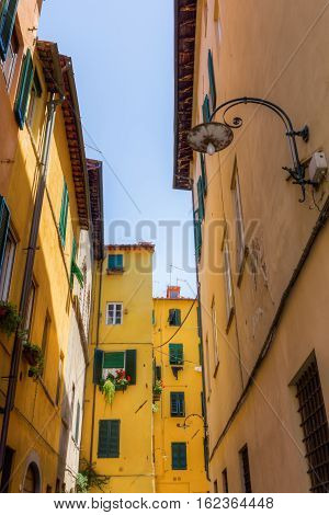 Alley With Old Buildings In Lucca, Italy