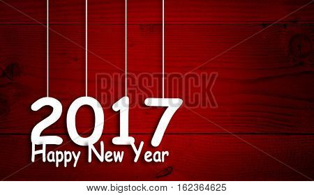 Concept or conceptual old wood or wooden red vintage horizontal December background with 2017 Happy New Year message or greeting