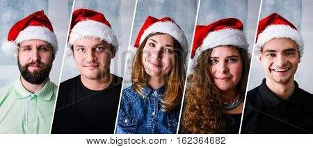 Group of people celebrating Christmas or New Year wearing Santa hat
