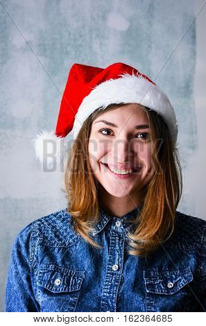 Christmas celebration portrait of young adult happy woman wearing Santa hat