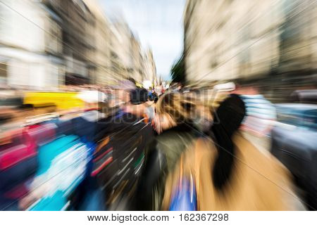 picture with zoom effect of crowds of pedestrians walking in the city