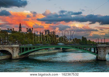 Seine Bridge In Paris With Dramatic Evening Sky