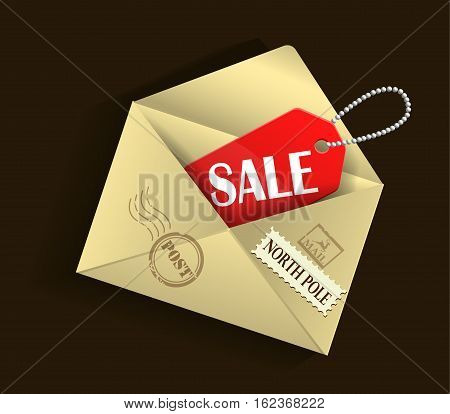 open beige xmas envelope with sale tag with postage stamps on brown background could be used for boxing day or Christmas or New year sales