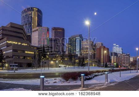 CALGARY, CANADA - DEC 17: Calgary's skyline at sunrise on a cold winter day on December 17, 2016 in Calgary, Alberta. Calgary is home to many oil companies. The Bow River walking path is visible.
