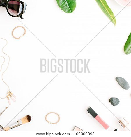 female summer bikini swimsuit and accessories collage on white with palm branches necklace and sunglasses. flat lay top view