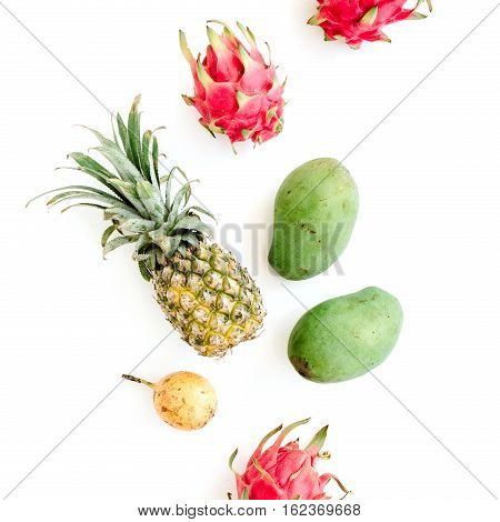Exotic fruits: mango pineapple passion fruit and dragon fruit. Flat lay top view