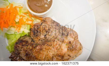 pork chop steak and salad on plate for dinner