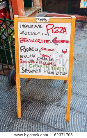picture of an outside menue board of an Italian restaurant