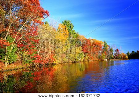 Autumn colors along Lake Wissota State Park shoreline in Wisconsin