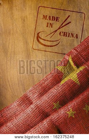 Flag of China and the stamp impression is made in China with chopsticks.