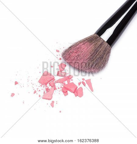Crushed compact blush pink color with makeup brush on white background