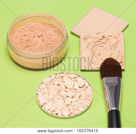 Basic makeup products to create beautiful skin tone and complexion: cream-to-powder foundation with flat brush, correcting, loose and compact powder