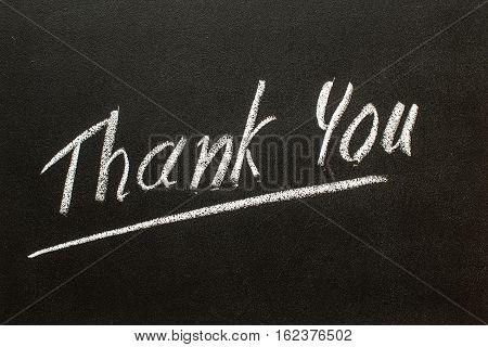 THANK YOU text written on  black chalkboard