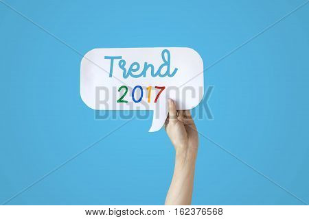 Human Hands Holding White Bubble Speech Of Trend 2017 Over Blue Background