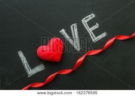 Love text written on chalkboard. Valentine's Day Concept