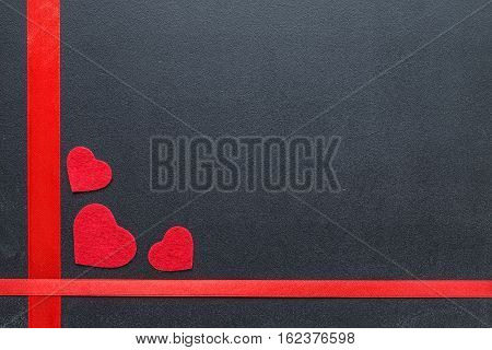 Red hearts on the chalkboard. Valentine's day