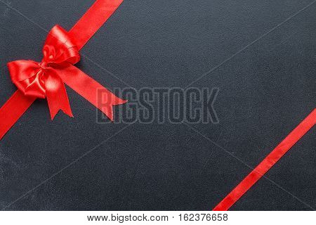Red ribbon on black boards, with free text space