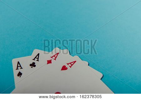 A Winning Poker Hand Of Four Aces Playing Cards
