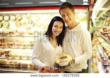 Portrait of young couple at confectionary s shop