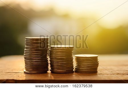 Rows of coins and account for finance and banking concept Money coin stack growing business Saving money concept