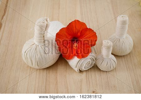 Beautiful spa composition with herbal compress balls, Hibiscus,towel