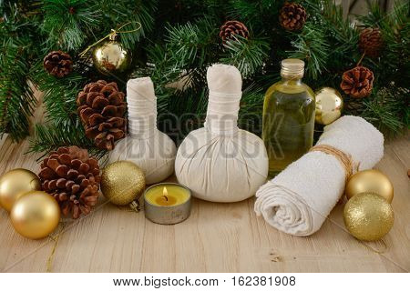Christmas spa with Composition of treatment and wooden table
