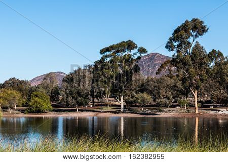 Lake Murray with trees and Cowles Mountain, part of Mission Trails Regional Park in San Diego, California.