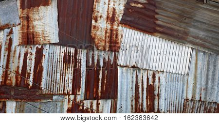abstract old rusty galvanized and corrugated steel panel