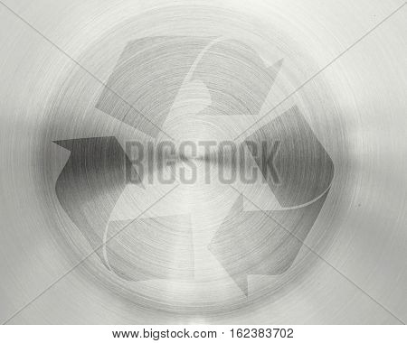 recycle sign on circular metal plate texture background