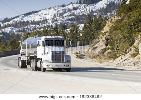Tanker Big Rig Semi Truck on Snowy Mountain Pass