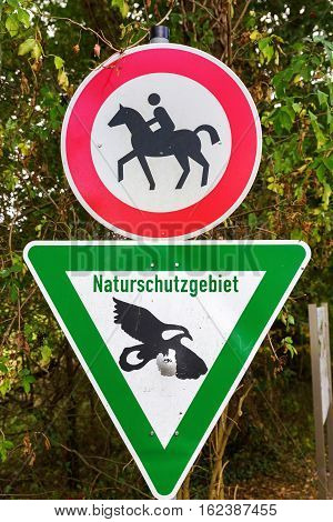 nature reserve sign and sign for riding forbiddance in Germany